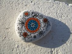 This is one of my spontaneous hand painted and drawn patterns, drawn and painted on a gessoed beach stone I found on a beach in Tenerife. I love to create patterns freehand and spontaneously, making each unique. Painted carefully in acrylics by freehand and then drawn over in pen. I like to create designs that provide a bit of inspiration and beauty for peaceful moments. This an original piece of miniature art and would make a unique gift. Signed on back by me.  The size is approx. 5cm wide…