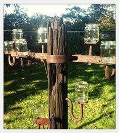 repurposed old telephone pole. outdoor candle holder