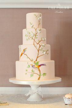 'HUMMINGBIRD' Wedding Cake - Hand painted hummingbird and tree design over a peach iced cake. #weddingcakedesigns