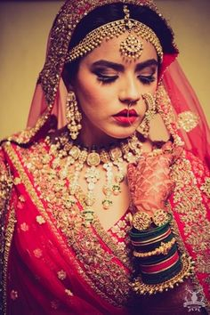 Bridal Portrait - Beautiful Bride Shradha in a Polki and Emerald Necklace, Gold Maatha Patti, Nath and Green Bangles | WedMeGood #realwedding #indianbride #indianwedding #bridal #lehenga #portrait #bangles #indianjewelry #jewelry