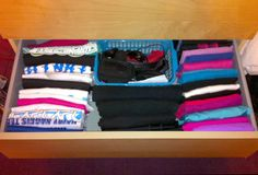 Organising workout gear.  Running shirts on the left, gym vests on the right, bottoms in the middle, accessories in a basket at the back.