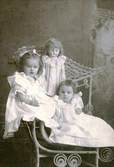 Antique photos of little girls and a doll.