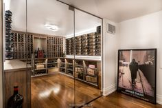 A beautifully designed walk-in wine cellar featuring custom millwork and highend racking. #winecellardesign #winecellarbuilders #custom #millwork #vintageview #timeless #designinspo Glass Wine Cellar, Wine Cellar Design, Wine Cellars, Wine Glass, Wood Wine Racks, Timeless Design, Construction, Traditional, Home Decor