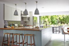 blue and white open plan kitchen theROOMedit