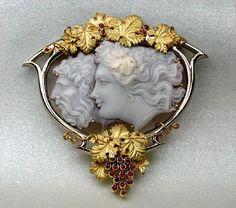 "Cameo Brooch ""Pan and Diana"", 22Kt Gold, cabochon rubies as grapes"