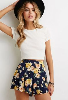 SPRING & SUMMER FASHION TRENDS! Ask your Stitch Fix stylist for items like this when you sign up today by clicking on the pic & filling out your style profile. Only $20 to have your own stylist! #affiliate #stitchfix  navy floral print lightweight shorts, white cropped top and hat.