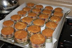 Who woulda thought...Use canning lids on a sheet pan to hold paper cupcake liners, so you can bake more cupcakes/ muffins at one time.