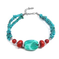 This bracelet is formed with turquoise stone and coral chips. A perfect addition to a distinctive style, this piece was handcrafted by Karen hill tribe craftsmen.