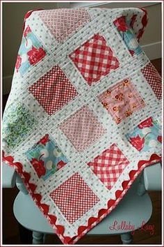 Quilt ~ plain blocks with sashing. puts the focus on the fabric. Interesting way of doing the rick rack