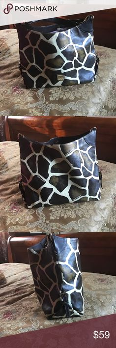 Dooney & Bourke Handbag Brown and cream giraffe print leather. Interior has zipper pocket and smaller side pocket with key fob. Silver Dooney & Bourke nameplate on front. Lining is slightly soiled, corners have a little wear and handle is in good shape. In EUC Dooney & Bourke Bags Shoulder Bags