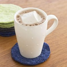 sweater coasters.  I have lots of old sweaters.  This is a great idea.