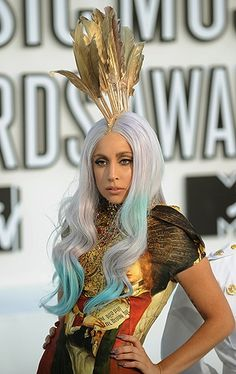 Lady Gaga wearing a gold feather mohawk headpiece at the 2010 MTV Video Music Awards.