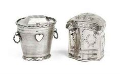 Two Dutch silver 'lodderein' snuff-boxes  One with the mark of Jan Koning Kuitert, Groningen, 1821; the other with the mark of Albert Jan Froon, Groningen, 1839  The first in the shape of a cabinet, the back inscribed: 'DIT KABINET HEB IK VAN DOEN HET IS ALWEER EEN NIEUW FATZOEN', marked on interior base; the second in the shape of an oval basket, reeded and centered with a heart, marked on cover and on base  4 cm. high max.  42 gr. (2)