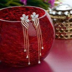 Gold earrings are one of the common and often used jewelry till date. Gold hanging earrings are in trend with heavy designs of gold and diamonds. Jewelry Design Earrings, Gold Earrings Designs, Gold Jewellery Design, Ear Jewelry, Designer Earrings, Necklace Designs, Bridal Jewelry, Jewelery, Gold Jewelry