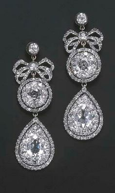 A PAIR OF VERY FINE 18TH CENTURY DIAMOND EARRINGS  Each designed as a detachable drop-shaped cluster pendant to the diamond bow, cluster and collet top, mounted in silver, circa 1770, 6.0 cm. long.  #GeorgianEarrings #GeorgianDiamondEarrings #RococoJewelry