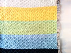 The Dina blanket is the perfect bright & gender neutral baby blanket. This baby blanket knitting pattern uses only knits and purls to make up the pattern. Crochet Blanket Patterns, Baby Patterns, Knitting Patterns, Knitting Projects, Crochet Pattern, Knit Crochet, Easy Knit Baby Blanket, Knitted Baby Blankets, Baby Receiving Blankets