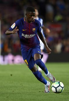 Ousmane Dembele of Barcelona runs with the ball during the La Liga match between Barcelona and Espanyol at Camp Nou on September 9, 2017 in Barcelona.