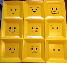 """Lego face plates. I found a basic Lego Man face on Google, printed it, cut out the eyes, mouth etc, and used that as a template so the faces are centered and similar. Then using a Sharpie added my own creative expressions with my son's suggestions. """"Now make an angry one, Mommy!"""""""