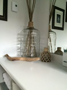 This is an old wine Carboy, glued a little bit of rope around the neck, add a few decorative sticks, and voila! A beautiful piece to add in any decor glass bottle crafts Glass Bottle Crafts, Glass Bottles, Wine Bottles, Antique Bottles, Antique Glass, Glass Water Jug, Gallon Glass Jars, Decorated Jars, Bottle Lights