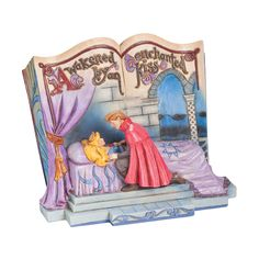 "Amazon.com: Disney Traditions by Jim Shore Sleeping Beauty ""Enchanted Kiss"" (4043627): Home & Kitchen"