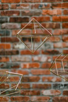 gold hanging geometric shapes - photo by Amber Gress Photography Wedding Party Favors, Wedding Centerpieces, Diy Wedding, Dream Wedding, Wedding Ideas, Woodland Wedding, Wedding Bells, Wedding Decor, Wedding Stuff