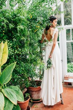 Backless wedding dress | Amy Lewin Photography | see more on: http://burnettsboards.com/2015/01/botanical-beauty-greenhouse-wedding-editorial/