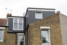 Rear dormer loft conversion with l-section conversion (loft pod). Clad in imitation slate. Constructed by Simply Loft on a property in South East London