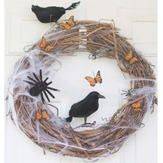 Decorate a basic wreath form with your favorite holiday goodies. We love how this blogger paired colorful butterflies and spooky crows and spiders for the perfect combination of tricks and treats. Get the tutorial at The Tortoise And The Hare.