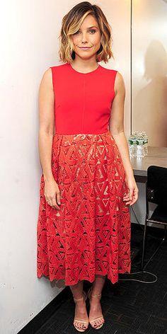 Sophia Bush in an orange midi dress with lace skirt