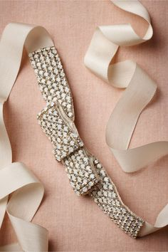 An ivory embellished bridal belt w/ opals & crystals is one way to spiffy up a simple #wedding dress.