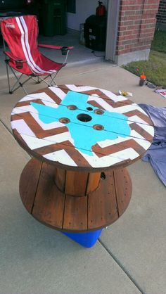 Wooden cable spool painted side patio table. I think I might do this with Oklahoma in orange and a heart where Stillwater is. Black and white chevron stripes