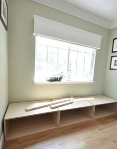 three Ikea cabinets used to create a window seat; build base and add cushion to these 15 inch cabinets to get correct seating height