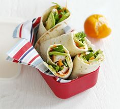 Chicken, carrot & avocado rolls. Healthy, quick and simple tortilla wraps with shredded chicken, vegetables and salad - perfect for little lunchboxes