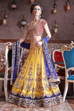Reception Outfits - Mango yellow raw silk 10 panel traditional Indian lengha with pink mirror embroidered blouse and a blue net scarf