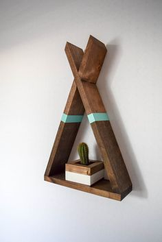This listing is for one Teepee shaped floating shelf with aqua stripe accent. Hanging this shelf is a breeze! We include a 2 inch finishing