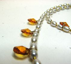 Pale dove grey necklace with topaz crystals  $65.00