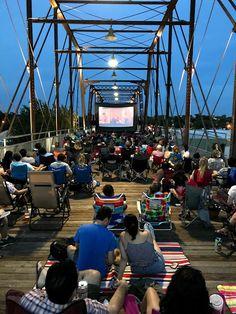 Darjeeling Limited screening on historic Hays Street Bridge in San Antonio by Slab Cinema, as part of Wes Anderson Film Festival. Outdoor Cinema, Darjeeling, Wes Anderson, Movie Theater, San Antonio, Film Festival, Bridge, Around The Worlds, Street