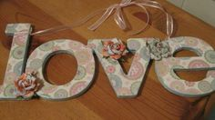 An instructional article on how to decorate decoupage style with paper or  wooden words and letters. Great idea for a child's nursery!