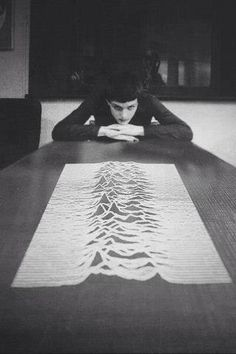 Ian Curtis, contemplating the Peter Saville design for the cover of 'Unknown Pleasures'.