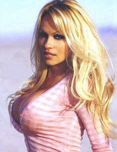 Dont you just love when a woman looks good in almost anything that she wears?    Ana Mancini  ( no thats not me, Thats Pamela Anderson! )