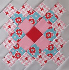 Great Granny Quilt Square - I like that all the scrappy squares in this quilt have a unifying red square in the middle.
