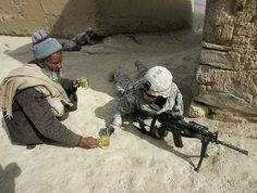 8. - Purple Clover - Purple Clover An Afghan offers tea to a thirsty soldier.