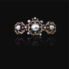 THE PROPERTY OF GRAF DOUGLAS, FORMERLY IN THE JEWELLERY COLLECTION OF THE PRINCES VON THURN UND TAXIS Pearl and diamond brooch, 1880s