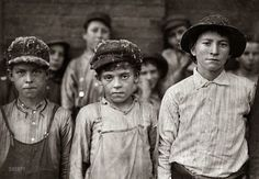 "November 1910. Pell City, Alabama. ""Doffers in Pell City Cotton Mill. Superintendent of mill is also Mayor of Pell City."" Photograph by Lewis Wickes Hine for the National Child Labor Committee."