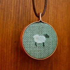 Cross Stitched Sheep Embroidery Hoop Pendant.