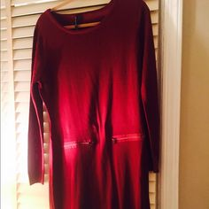 Burgundy long sleeve sweater dress Marc New York Andrew Marc... Burgundy long sleeve sweater dress.  Features two zippers in the front below the waist.  Material:  100% Acrylic Dresses Long Sleeve