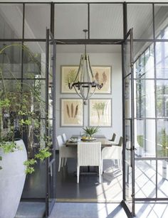 Beautiful Dining Room with Gorgeous Windows by Ann Holden. Photography by Paul Costello.  #design #interior_design #Home