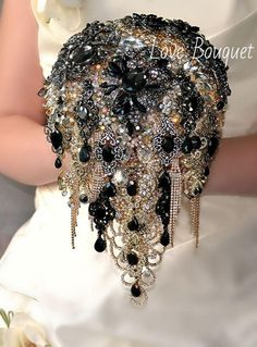 Black Brooch Bouquet, Cascading Black and Gold Silver Wedding Bouquet, Bridal Bouquet, Jewelry Bouquet, Crystal Gothic Wedding BouquetPleased to offer very beautiful and modern wedding brooch bouquet. This deluxe bouquet will be a great addition to the wedding bride. Only good materials and brooches are used when I am creating wedding bouquets special for you my dear bride! I will try to make your wedding day unforgettable with luxury brooch bouquet! The price for this bouquet depends...