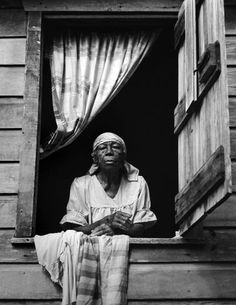 Woman Looking From Window, Belize, 1983