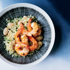 A tangy, caper-studded couscous with butter beans and lemon juice makes a delicious base for quickly sautéed spicy shrimp.
